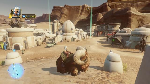 Ahsoka sitzt auf einem felligen Reittier auf dem Planeten Tatooine.
