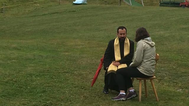 Ravarenda catolic cun dunna che vul cuffessar