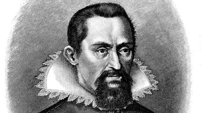 Johannes Kepler schreibt mit einer Feder.