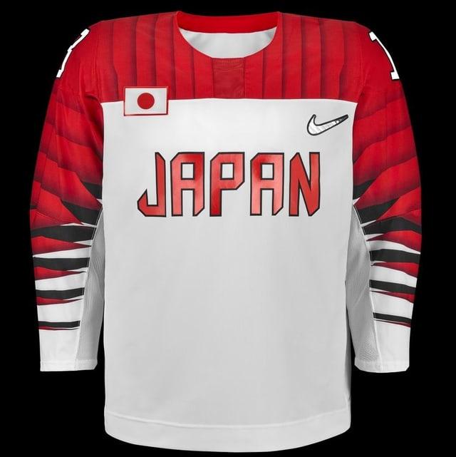 Japan tritt mit weissem Grund, rotem Oberköprer und schwarz-roten Armen an.