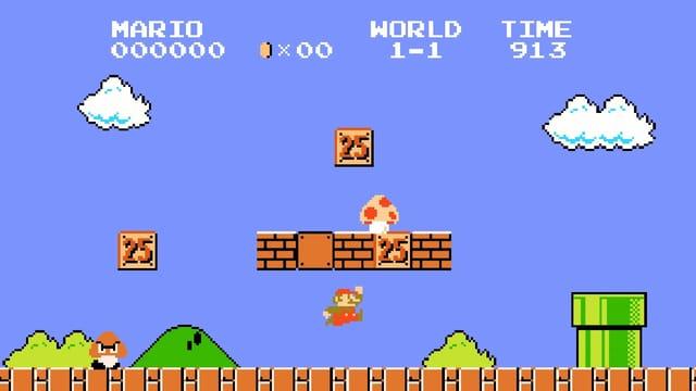"""Szene aus dem alten Videospiel """"Super Mario"""": Eine Figur hüpft durch eine pixlige Landschaft"""