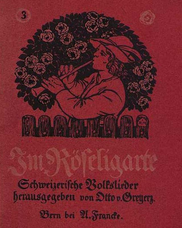 Schwarzer Druck auf rotem Grund: Ein Mann mit Hirtenhut spielt vor einem Rosenbusch auf seiner Hirtenflöte.
