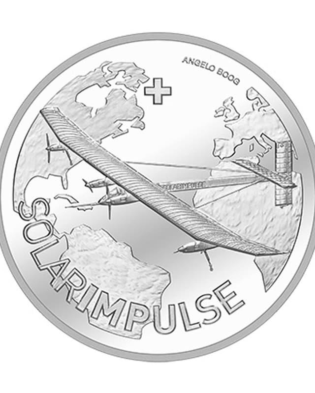 Silbermünze mit dem Flugzeug von Bertrand Piccard