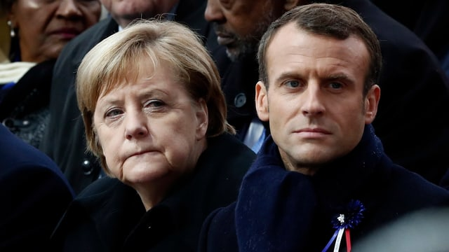 Gesichter von Merkel und Macron.