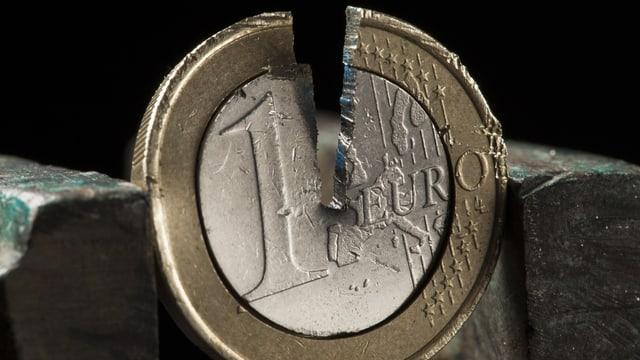 Ina munaida d'in euro sfendì.