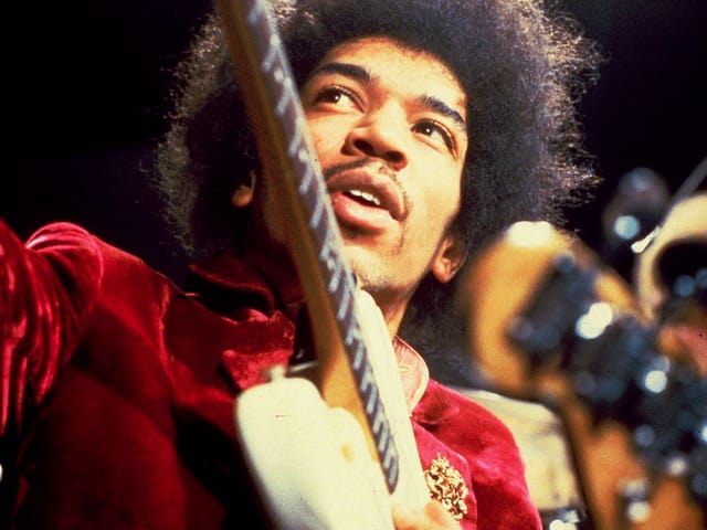Jimi Hendrix mit Gitarre