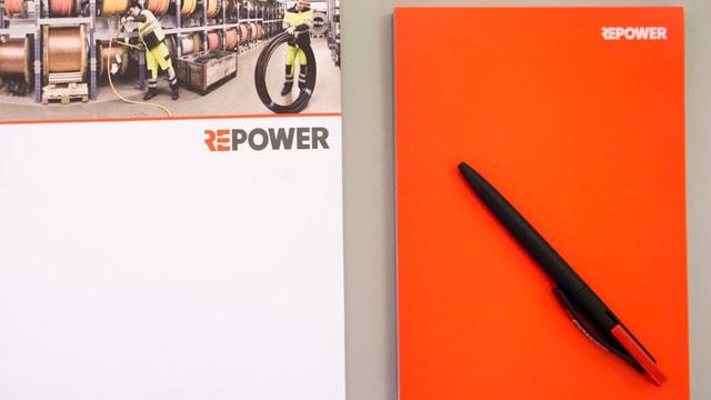 Il logo da la Repower ed ina mappa da medias.