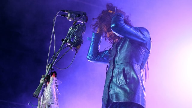 Sänger Wayne Coyne von der Band Flaming Lips auf der Bühne