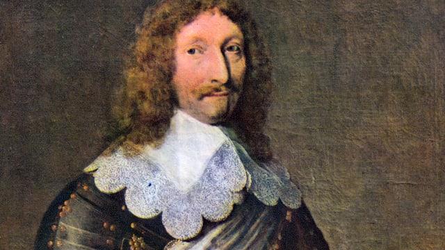 Ein Mann mit langen Haaren in einer Rüstung.