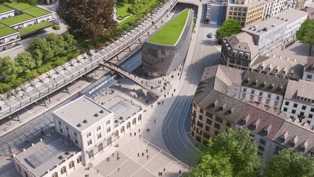 Blick von oben auf den Bahnhof Stadelhofen. Man sieht das rechteckige Bahnhofsgebäude. Daneben ein geschwungenes Gebäude aus Glas.