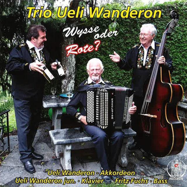 Ueli Walderon am Akkordeon, Ueli Wanderon jun. am Klavier und Fritz Fuchs am Bass bilden das Trio Ueli Walderon. Die drei sind auf dem Cover zur aktuellen CD «Wysse oder Rote?»  abgebildet.