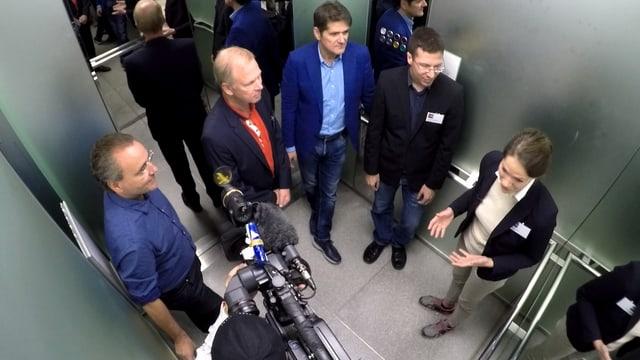 Menschen im Lift