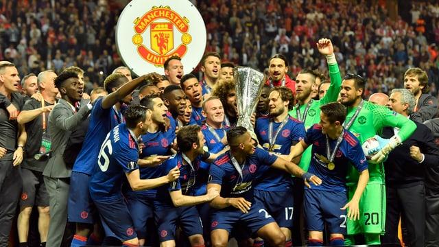 Ils giugaders da Manchester United cun il buccal.
