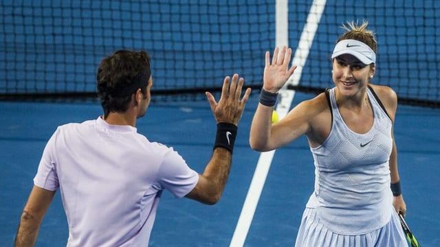 Belinda Bencic e Roger Federer.