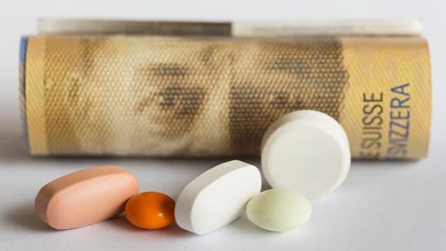 Geldschein und Tabletten