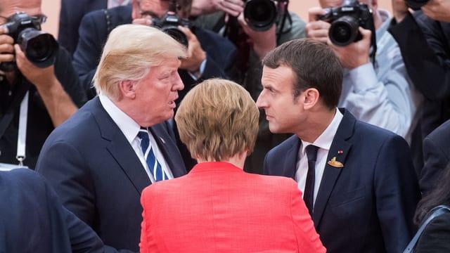 Donald Trump, Angela Merkel und Emmanuel Macron.