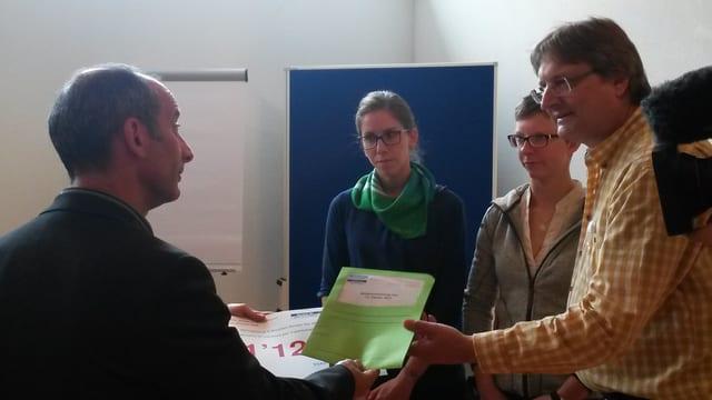 Franco Hübner (BSH), Melanie Rupf (SBK), Patrizia Kündig (VSAO) e Thomas Hensel (VPOD)