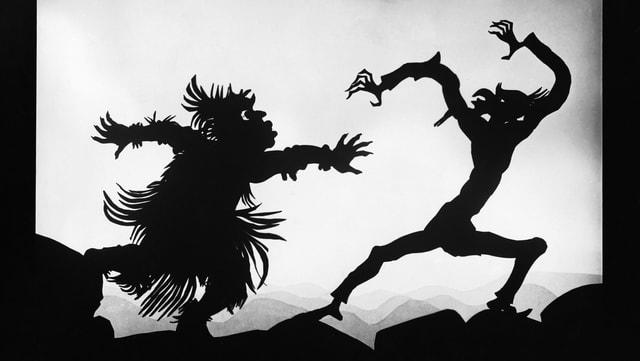 Scherenschritt: Monster greift Mann an