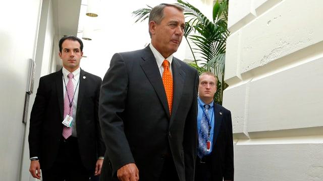 John Boehner, gefolgt von zwei Bodyguards
