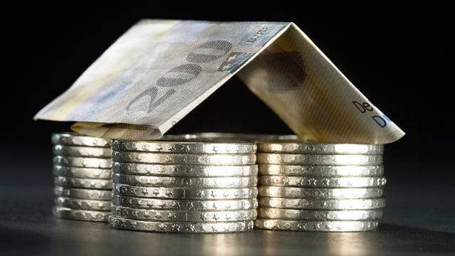 In bancnota da 200 francs tschentada sin in pluna munaida da 5 francs.
