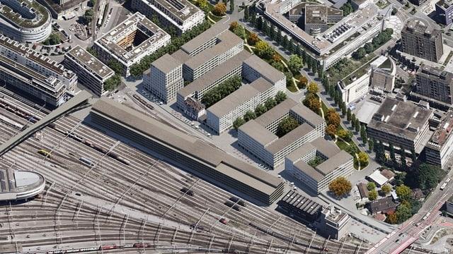 So könnte das neue Quartier dereinst aussehen: Ein langer Bürokomplex an den Geleisen, dahinter Gebäude mit Innenhöfen.
