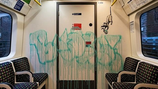 U-Bahn-Wagen – mit einer gemalten Ratte und der Banks-Signatur