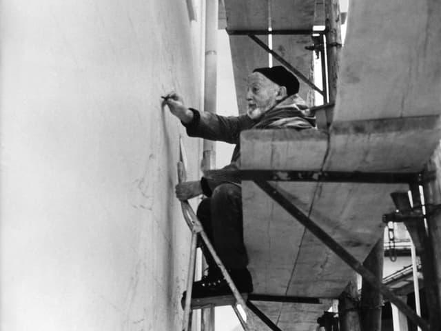 Alois Carigiet sin in palancau vid la lavur