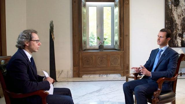 Ein Journalist interviewt Baschar al-Assad