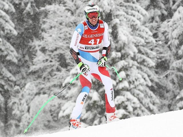 Marc Gisin unterwegs auf den Skiern, lächelnd