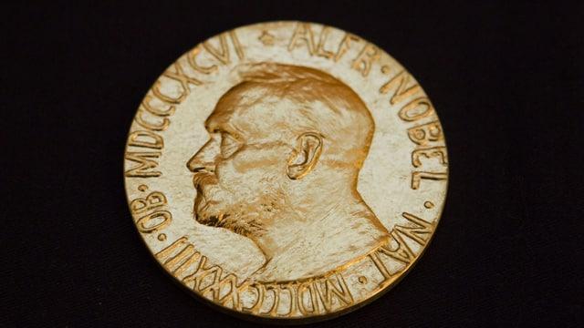 Goldene Münze mit Alfred Nobel