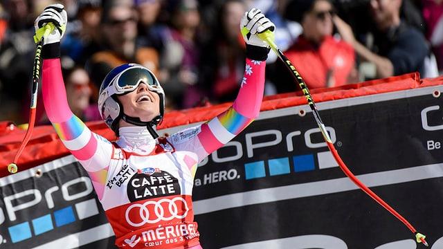 La skiunza americana Lindsey Vonn celebrescha sia victoria en l'arrivada da la cursa rapida a Méribel.