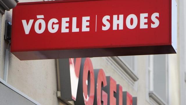 Il logo da Vögele Shoes vi d'ina butia.