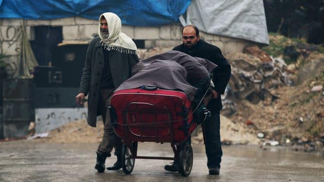 Civilists en la citad d'Aleppo.