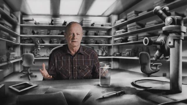 Ein Mann sitzt vor einem gezeichneten Labor in dem viele Geräte stehen und erklärt etwas.