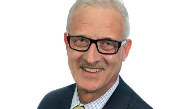 Porträt von Gemeindepräsident Beat Giauque.