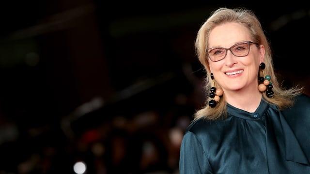 Meryl Streep lacht.