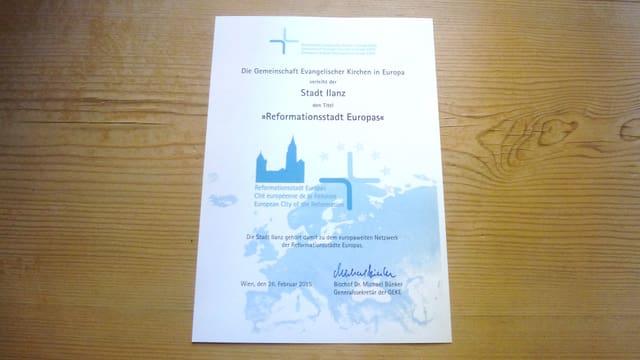 """Il document uffizial da la CBEE, che attesta a la citad da Glion il label sco """"Citad europeica da la refurmaziun""""."""