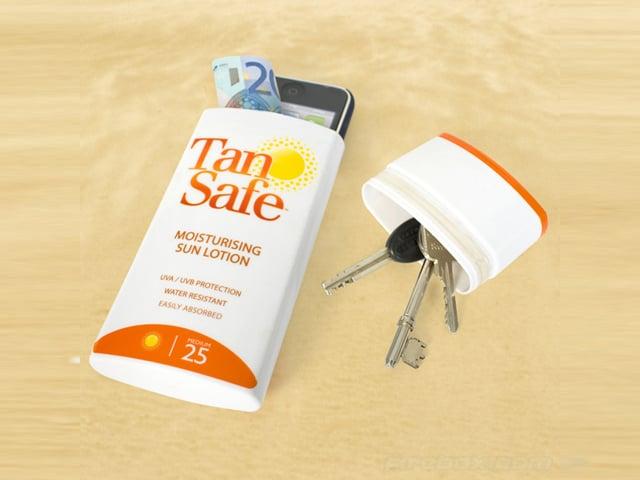 Aufgeschnittener Sonnencrème-Behälter mit Wertsachen darin.