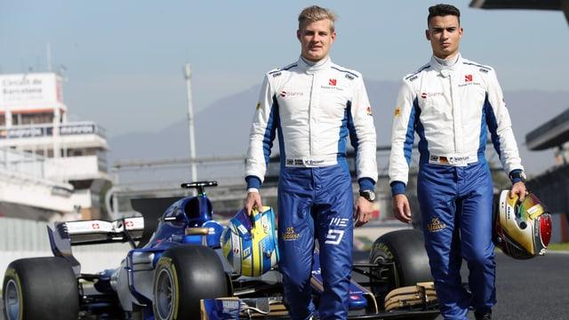 Marcus Ericsson und Pascal Wehrlein (neu) vor dem neuen Sauber C36.