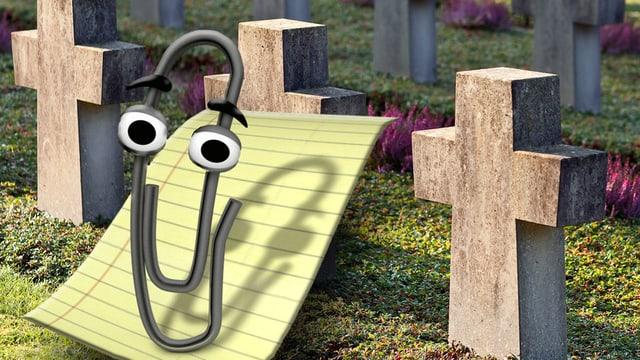 Die Briefklammer Clippy vor dem Hintergrund eines Friedhofes.