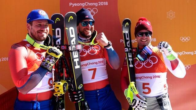 Trais skiunzs alpins.