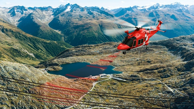 Il sistem da laser fa attent il pilot sin in obstachel, en quest cas ina lingia d'auta tensiun.