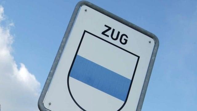 Ein Ortschaftsschild, beschriftet mit ZUG und mit dem Kantonswappen darunter.