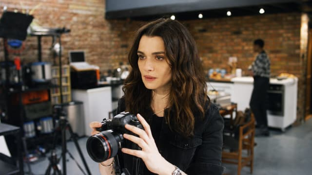Frau mit Kamera.