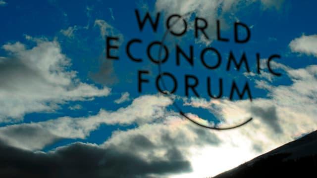 Signet dal WEF davant in tschiel cun nivels e sulegl