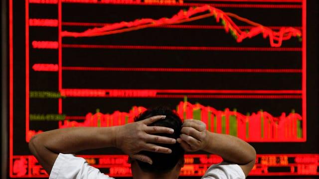Börsenhändler in Peking
