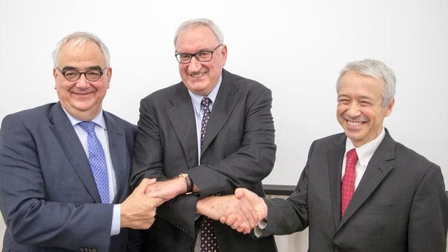 Clozel mit den Verhandlungsführern von Johnson&Johnson, 26.1.2017 in Allschwil.