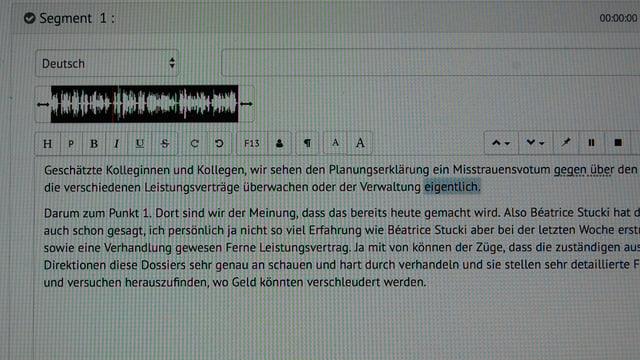 Bildschirm-Aufnahme mit Text und Audiokurve.