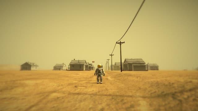 Der Astronaut steht vor einer verlassenen Siedlung sowjetischer Holzhäuser.