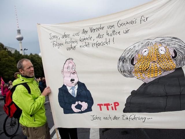 Anti-TTIP-Transparent mit Anspielung auf Gen-Mais und Merkel